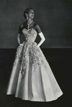 1953 Pierre Balmain. This image shows what Balmain gowns looked like in the 50's and how these designs have evolved.