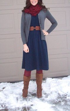 Maroon tights & scarf, navy dress, gray sweater, brown belt and brown boots. Modest winter fashion. Cute work look.