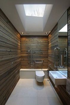 PANELING AND BOARDS -   The wooden panels lining the walls of the room provide a nice sense of security, which is key for a room like this, which is a restroom. Perfect feeling of security.