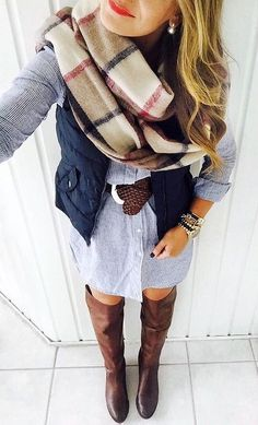 Denim/chambray button up dress, brown riding boots, navy vest, brown belt, and blanket scarf. Fall cute outfit