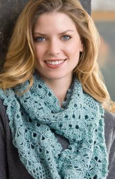 Named the Infinity scarf because it is a complete circle, you'll love the seemingly endless ways you can wear it. This crocheted scarf is perfect as a daytime accessory, practical for keeping your neck warm or romantic when worn over bare shoulders.  free pdf from Red Heart