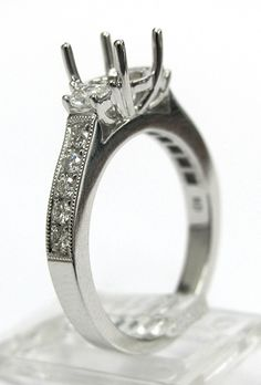 Ladies 14kt white gold semi mount. Mounted in ring are 10 brilliant round cut diamonds and 2 half moon cut diamonds weighing a total of .52ct total weight. Mounting is made to take approximately 1.00ct round cut diamond in the center.