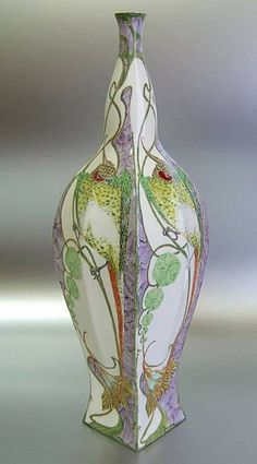 H.G.A. Huyvenaar, 1900, 12.6 inch vase, with a decoration of four parrots, each on a branch, and between exotic flowers.