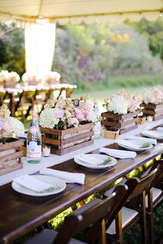 wine crate centerpieces Photo credit: Ken Kienow Why we love it: Place your flowers in upcycled wine crates for a lovely vintage vibe!