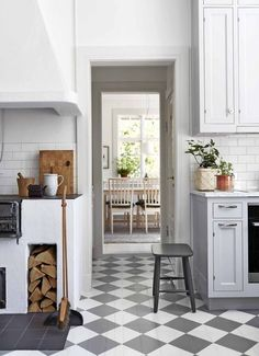 This is something I would love to have on my summer house - rustic cottage kitchen with checked floor and a woodburning cooker stove Modern Kitchen Cabinets, Kitchen Flooring, Rustic Kitchen, Kitchen Decor, Swedish Kitchen, Wooden Cabinets, Country Kitchen, Kitchen Design, Living Room Interior