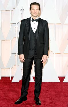 Bradley Cooper nominated for Best Actor, the American Sniper star wore a three-piece tuxedo by Salvatore Ferragamo, Johnston Murphy shoes, Montblanc cufflinks, and an IWC timepiece at the Oscars 2015 (held in Hollywood on Sunday, Feb. 22).