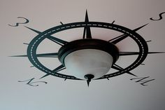 Compass Rose Light Fixture.  Paint or place decal around a plain light fixture.  Would be so charming if in the right room.  Nautical bathroom or in a study?
