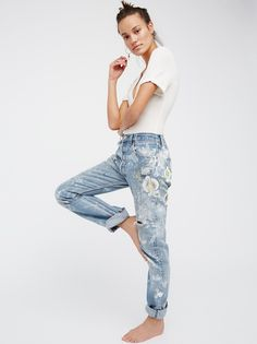 Orchid Jean | In a boyfriend, slouchy fit these mid-rise jeans are made from vintage Levi's 501. Featuring American hand painted white orchids and paint splatter details.    * Five-pocket style. * Button fly.