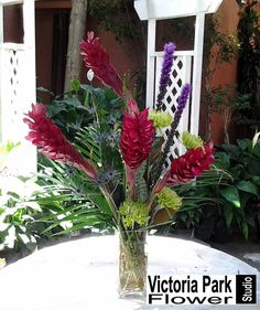 Custom Arrangement Designed With Ginger, Thistle, Fuji Mums & Liatris