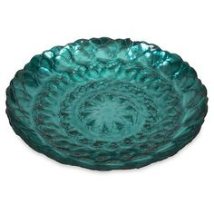 Glass bowl with a textural blossom motif.   Product: BowlConstruction Material: GlassColor: Blue...