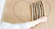 She Drew A Heart On A Piece Of Cardboard And Filled It With Tree Branches! The Result? ADORABLE!