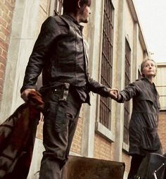 Norman Reedus and Melissa McBride as Daryl Dixon and Carol Peletier. Caryl lives on! Yuss!