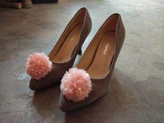 Grey pumps with pink pom pom