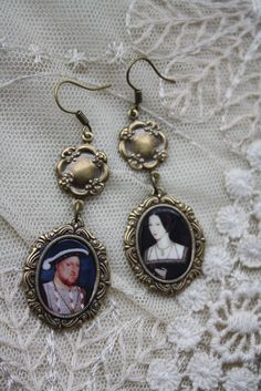Elizabeth I's parents, Henry VIII and Anne Boleyn EARRING SET. $24.99. Etsy link: http://www.etsy.com/listing/98225676/henry-viii-and-anne-boleyn-earrings?ref=sr_gallery_20_search_query=ELIZABETH+TUDOR_view_type=gallery_ship_to=ZZ_min=0_max=0_page=5_search_type=all#