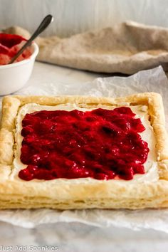 This Strawberry Mascarpone Puff Pastry bring breakfast sweets to a new level! Texture, flavor and indulgence all in one recipe!  #justaddsprinkles #puffpastry #strawberries