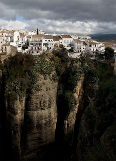 Ronda, Spain    Ronda does not sit upon one strategically significant hilltop in the Andalusia region of Spain. It sits upon two hilltops, only 68 meters (223 feet) apart but separated by the 120 meter (400 feet) deep El Tajo Gorge. Ever since the Celts first built Ronda it has been an issue how to bridge the two sections of town.