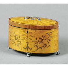 A George III oval satinbirch and marquetry tea caddy circa 1780 of unusually large proportions, with silver mounts, the lid monogrammed WEY, the interior with three tin tea cannisters, apparently original