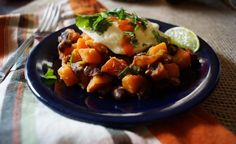 Spicy Sweet Potato, Chipotle, and Black Bean Hash Topped with an Over Easy Egg