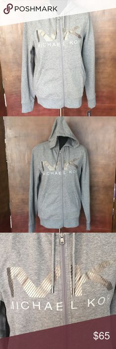 NWT Michael KORS Gray Hooded Sweatshirt NWT Michael KORS Gray Hooded Sweatshirt. The MK is a Pewter Green color. Has 2 pockets in front and zips up to close. Available in M, L and XL. Checkout my other listings and add to a bundle to save! Michael Kors Shirts Sweatshirts & Hoodies
