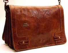 We love vintage bags like this from The Bridge - the leather develops such a beautiful patina with lots of love and use over the years. Rimowa, Vintage Bags, Briefcase, Italian Leather, Travel Bags, Oakley, Leather Bag, Messenger Bag, Fashion Inspiration