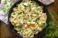 You don't need seafood to make this scrumptios classic pasta dinner! Pan-seared artichoke hearts, crispy tofu and tender linguine pasta are dressed in a lemon, garlic and white wine sauce to create this zingy and satisfying vegan scampi. #vegan #veganrecipe #vegetarian #vegetarianrecipes #tofu #meatlessmonday