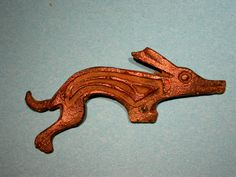 Roman running dog brooch in bronze, originally decorated with coloured enamel; Wiltshire Museum