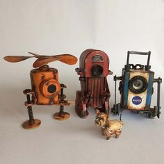 My 3 tiny robots with their pet Cosmo