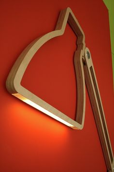 """Nepa Lamp By Giles Godwin Brown """"The Nepa Lamp is made from stainless steel and birch plywood, enveloped with aluminum detailing. It uses 12v to lighten up high powered LEDs, an energy saving innovation that makes illumination more cost effective and eco-friendly."""""""