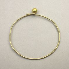 Ulno Bangle- Gold  Solid 18k Gold Bangle   Simple hook and ball closure   Hand-crafted in the David Neale Workshop
