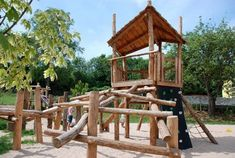 A look out tower surrounded by the many climbing, balancing, swinging and sliding opportunities we provided at King George V Playground in Plymouth.