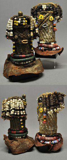 Africa | Dolls from Namibia or southern Angola | Wood covered in woven plant fiber and decorated with brass and glass.  Remains of kaolin