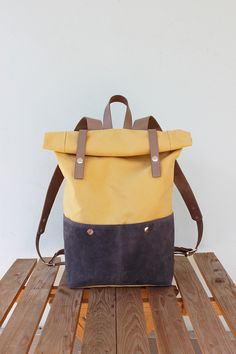Made of yellow color canvas and gray-blue suede (leather) with leather details. Size: 42х27х12 cm. Two external leather pockets with snap fasteners. Two pockets inside Beige lining Color:...