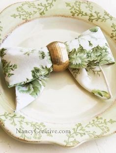 Directions for Bow Folded Napkin Love this Dinner ware, ad a bit of gold ribbon creates a nice look , maybe some green goblets, you get the idea!