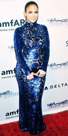 06/14/13: At the amfAR Inspiration Gala, Jennifer Lopez did it again with one of her sexy trademark looks. She flaunted her curves in a slinky body-skimming blue-sequined Tom Ford gown. #lookoftheday