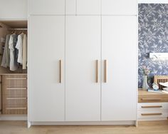 Clean white wardrobe with wooden handles