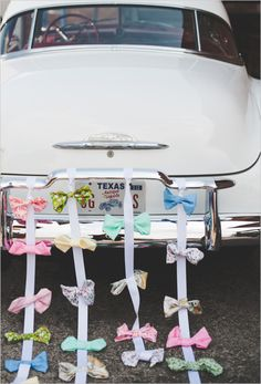 bows! Ahh I LOVE it! So much cuter than any wedding car decoration I've ever seen!