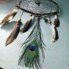 Made from branches which I foraged myself in the woods, this lovely dream catcher would make the perfect gift for both him, her and child ~  All materials are ethically sourced, from embroidery thread to naturally shed feathers. This is a made to order item so you are able to choose beads/feathers, thread colours as well as a choice of crystal from my stock  This dream catcher is 52cm in length