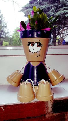 Purple Clay Pot Person / Flower Pot  This girl would be perfect to add to your indoor or outdoor décor! You can plant a flower in her or just leave