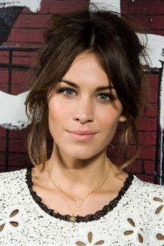 Very pretty make up and hair - corner 'flutter' eyelashes, pale pink lips and a fringe swept apart