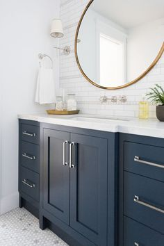 Marble mosaic floor and navy cabinets || Studio McGee