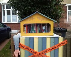 Is this the tiniest library you've seen? And who is trying to get out?!