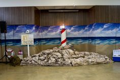 Cover  walls with an ocean scene setter and use butcher paper to create a shoreline.