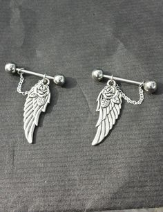 ok, if i did though..so cute. Wings SET OF 2 14G Barbell Nipple Rings on Etsy, $15.69 CAD