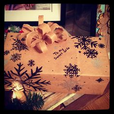 My husband made this wrapping paper out of paper bags! He even drew the snowflakes with a sharpie!
