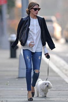 Olivia Palermo wearing jeans, a bomber jacket and flats