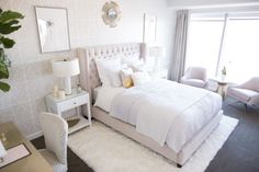 You can still get that hotel chic style if your room is carpeted. Layer a soft shag rug in a white or light color over the existing carpeting!