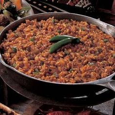 Spanish Rice with Ground Beef-1 can of crushed tomatoes and 2 cups brown rice
