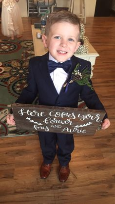 Adorable little ring bearer spotted wearing Black N Bianco Slim Navy Suit!