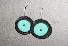 Slightly retro and totally fun, these burnished, hammered, turquoise enamel earrings add a fresh splash of color to your day. Theyre super light weight and easy to wear. The dangle earrings are 7/8-inch wide and measure just under an inch long from the top of the ear wire. The highly burnished, patinated copper base is heavily textured with strike marks on the outer edge. Theyre also available in horizon blue, lime peel, mellow yellow, and orange (see color chart included with listing)…