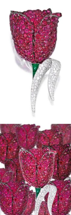 18 Karat White and Blackened Gold, Ruby, Diamond and Emerald 'Tulip' Brooch, Michele della Valle Designed as a voluminous tulip blossom, the petals set with numerous round and oval-shaped rubies weighing 86.15 carats, the leaf set with single-cut diamonds weighing 5.30 carats, completed by a stem set with three emeralds weighing 2.05 carats, signed Michele della Valle, numbered 150753